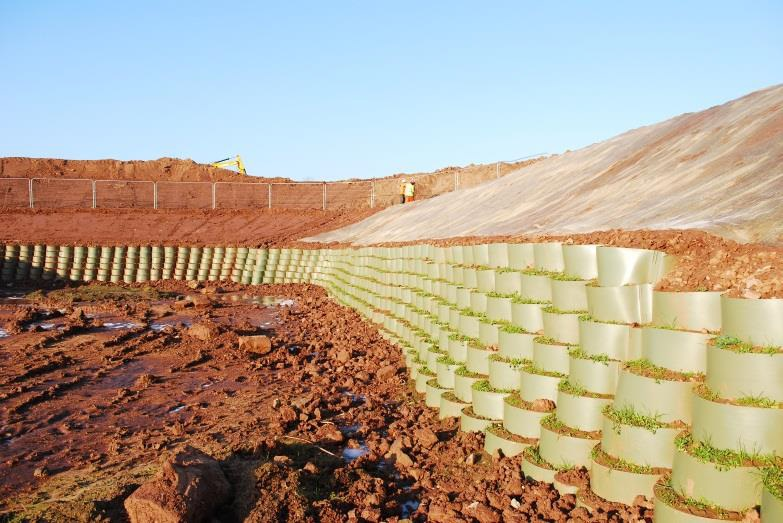 Grass Retaining wall for attenuation pond using ABG Geosynthetics Webwall Geocell