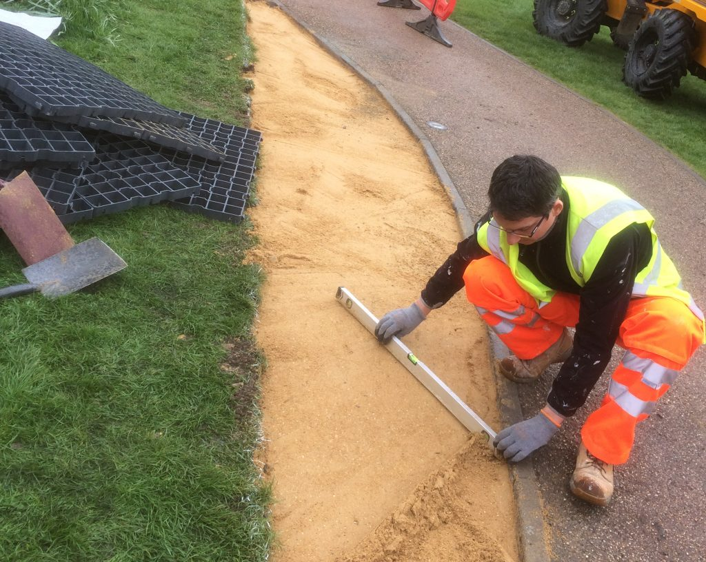 Geogreen team working on a permeable paving installation