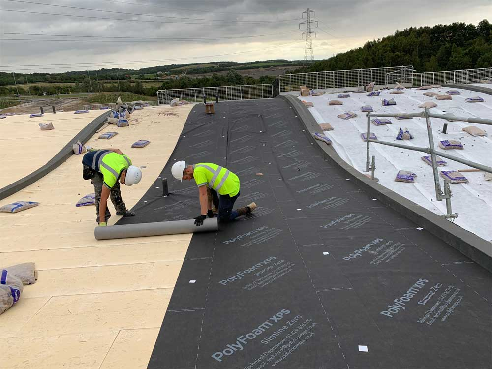 Installing the waterproof membrane on the green roof