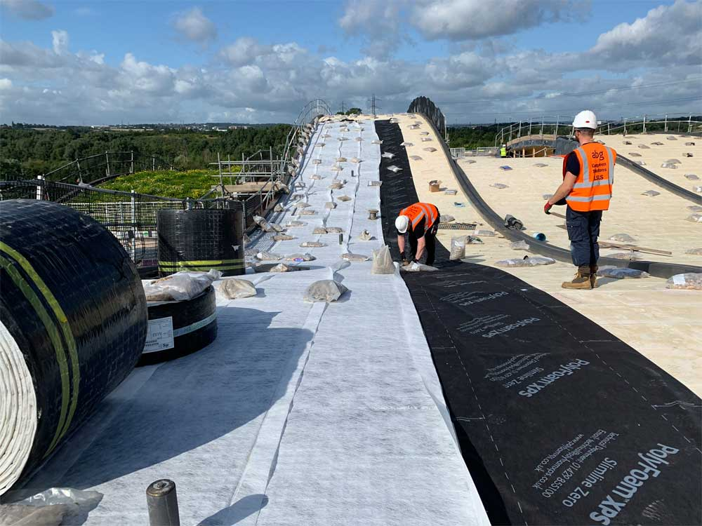 Roofdrain Geocomposite from ABG Geosynthetics being installed on the Extensive green roof