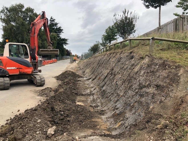 Excavating the embankment face